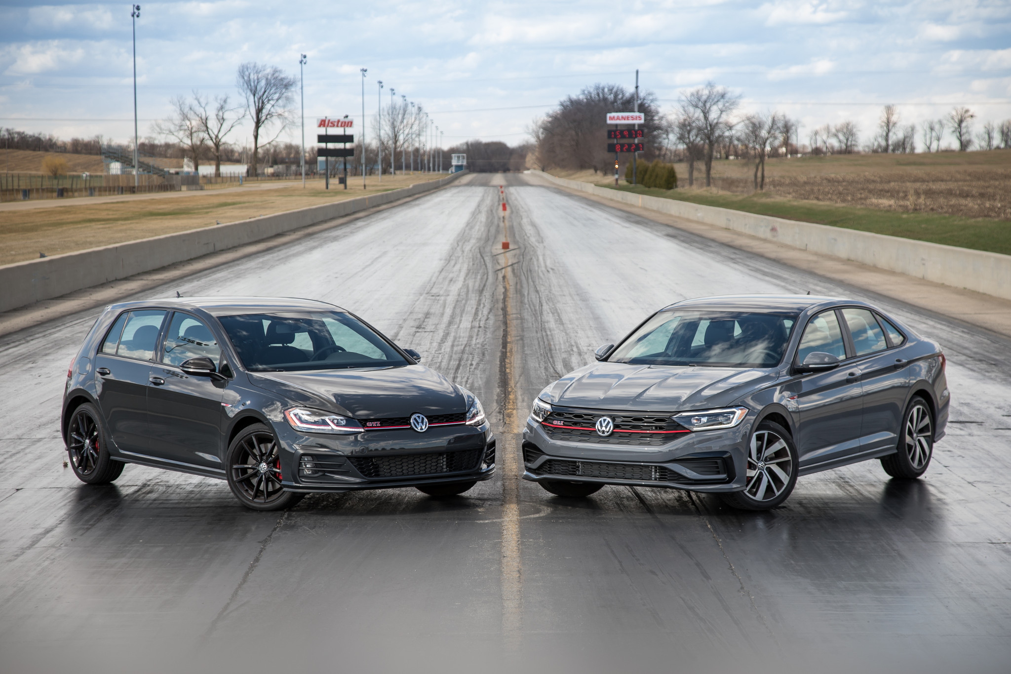 01-volkswagen-jetta-gli-and-golf-gti-2019-angle--drag-strip--exterior--front--grey--head-to-head.jpg