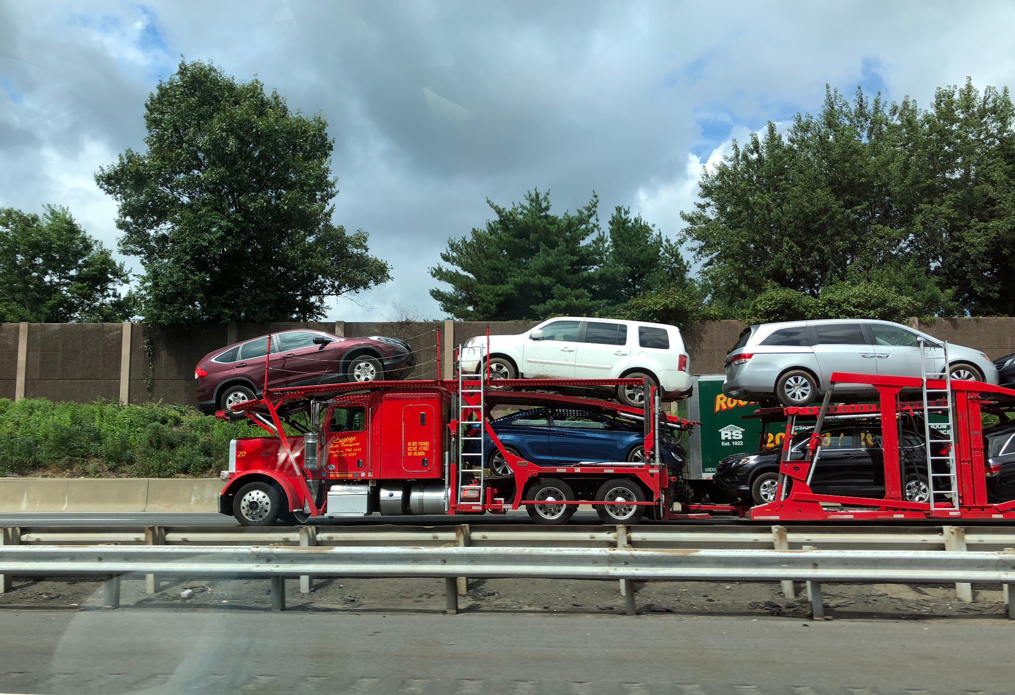 a-car-carrier-trailer-known-variously-as-a-car-carrying-trailer-car-hauler-auto-transport-trailer-