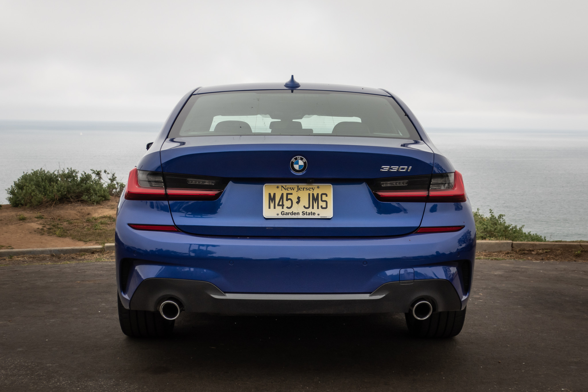bmw-330i-2019-07-blue--exterior--rear.jpg