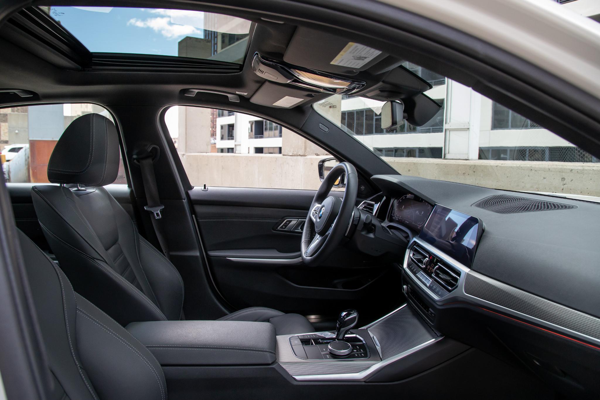 bmw-330i-2019-27-front-row--interior.jpg