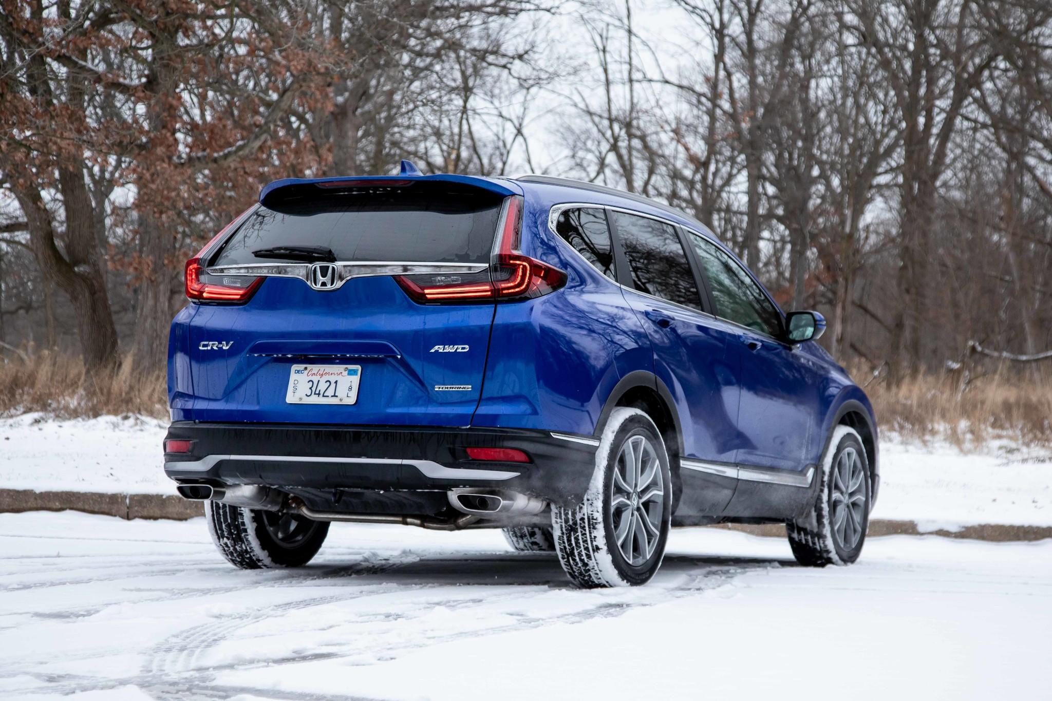 honda-cr-v-2020-05-angle--blue--exterior--rear.jpg