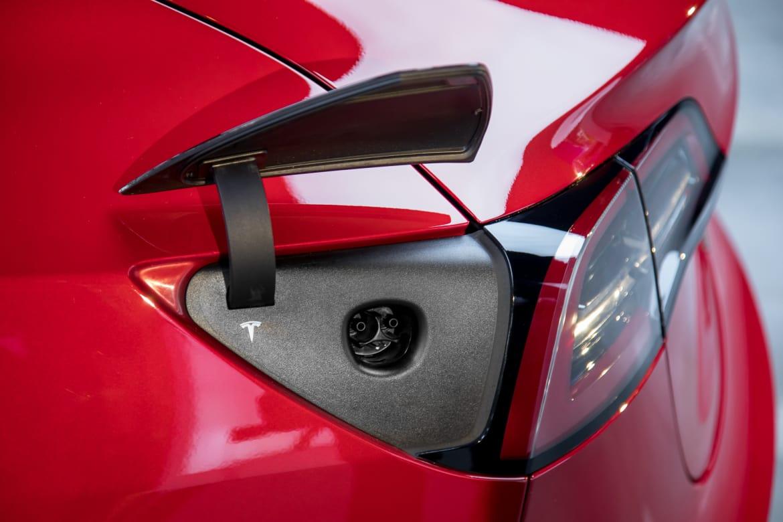 10-tesla-model-3-2017-charging port-exterior-red.jpg