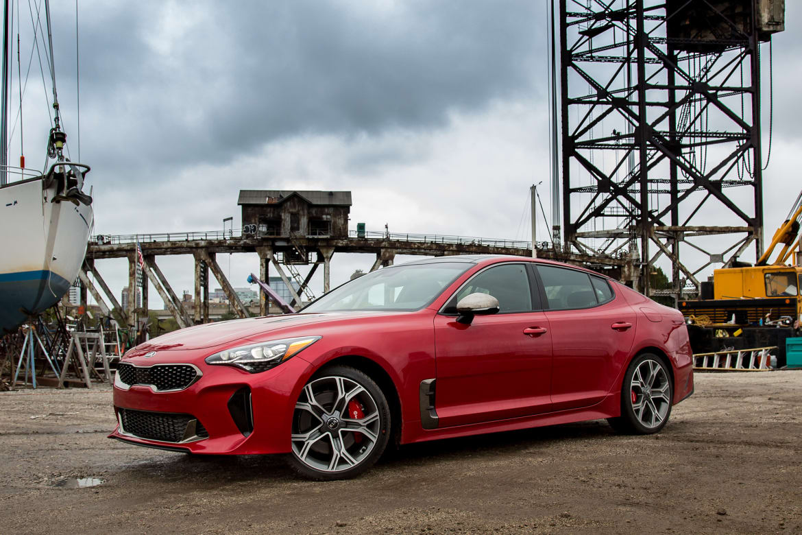2000px-02-kia-stinger-2018-angle-exterior-front-red-CL.jpg