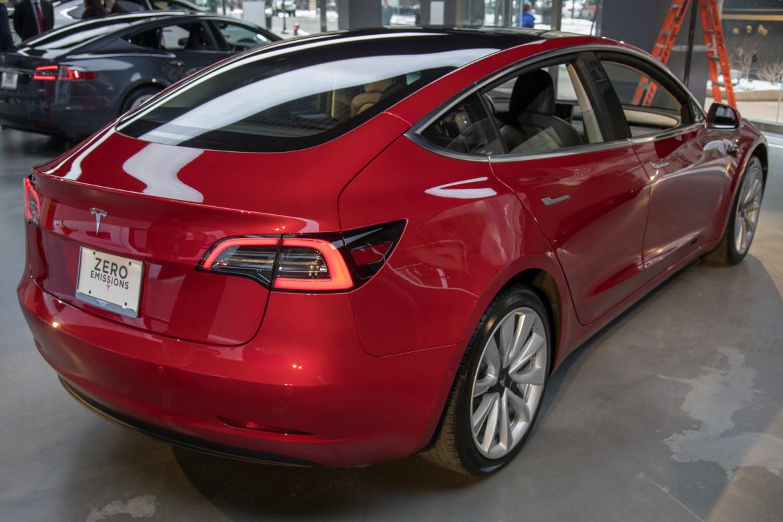 05-tesla-model-3-2017-exterior-rear angle-red.jpg
