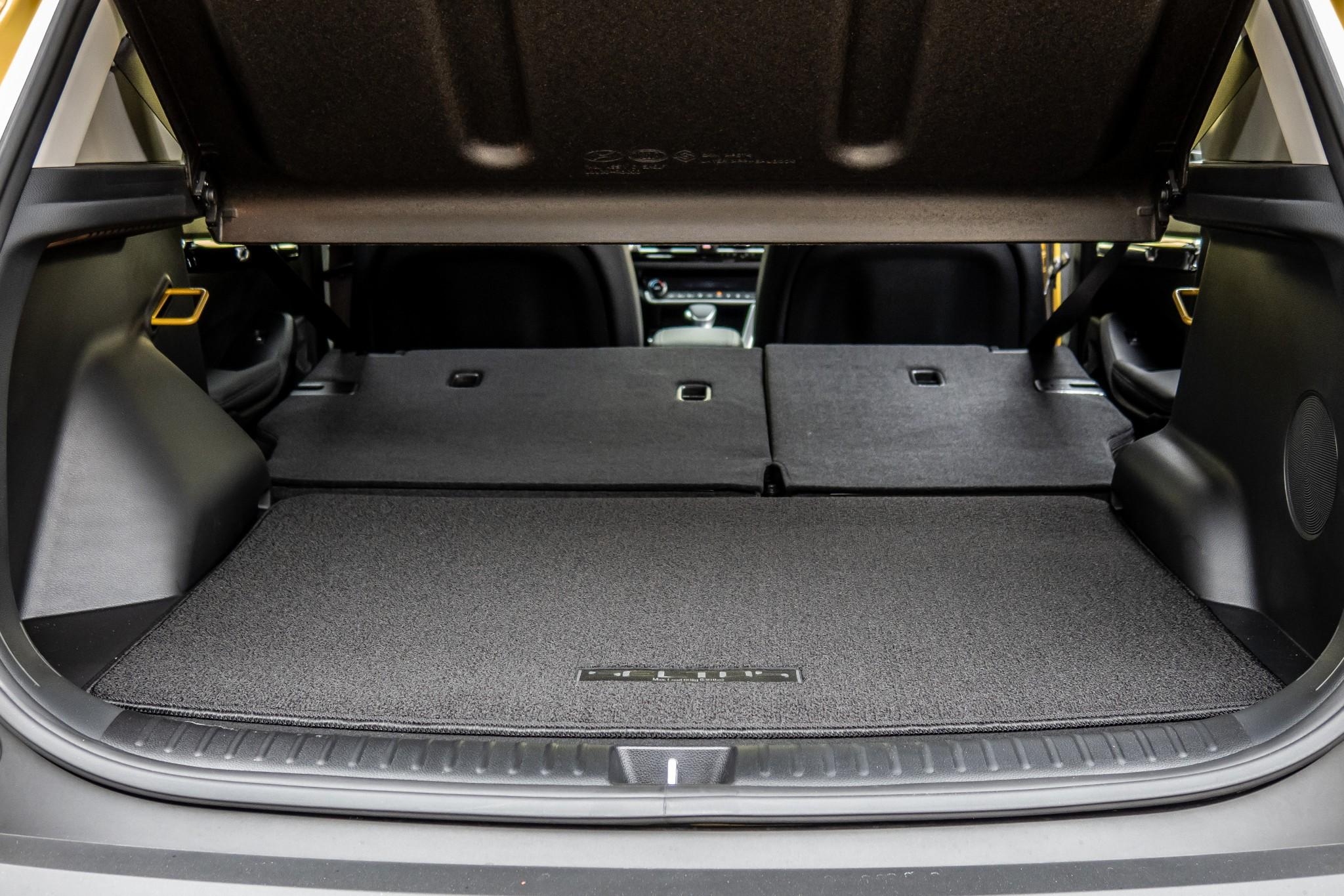 kia-seltos-2021-39-folding-seats--interior--rear--trunk.jpg