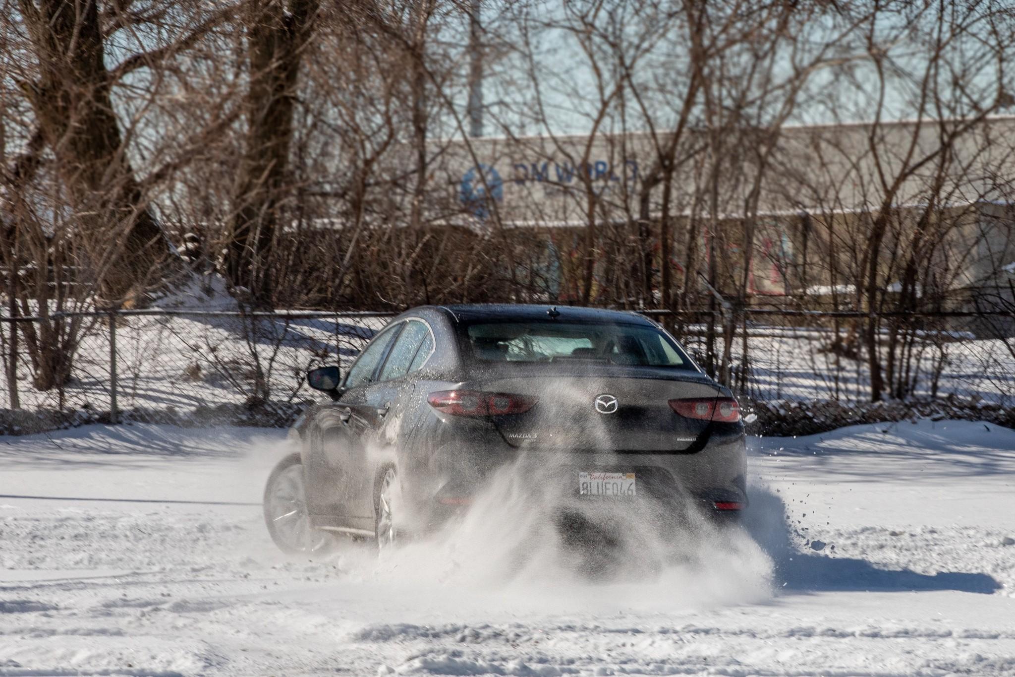 mazda-3-2020-4-angle--dynamic--exterior--grey--rear--snow.jpg