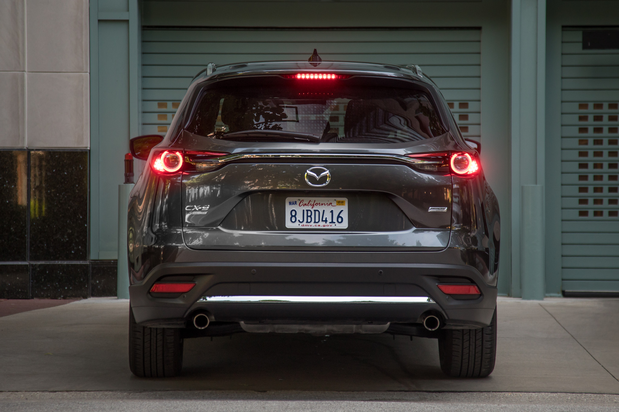 mazda-cx-9-2019-08-exterior--grey--rear--urban.jpg