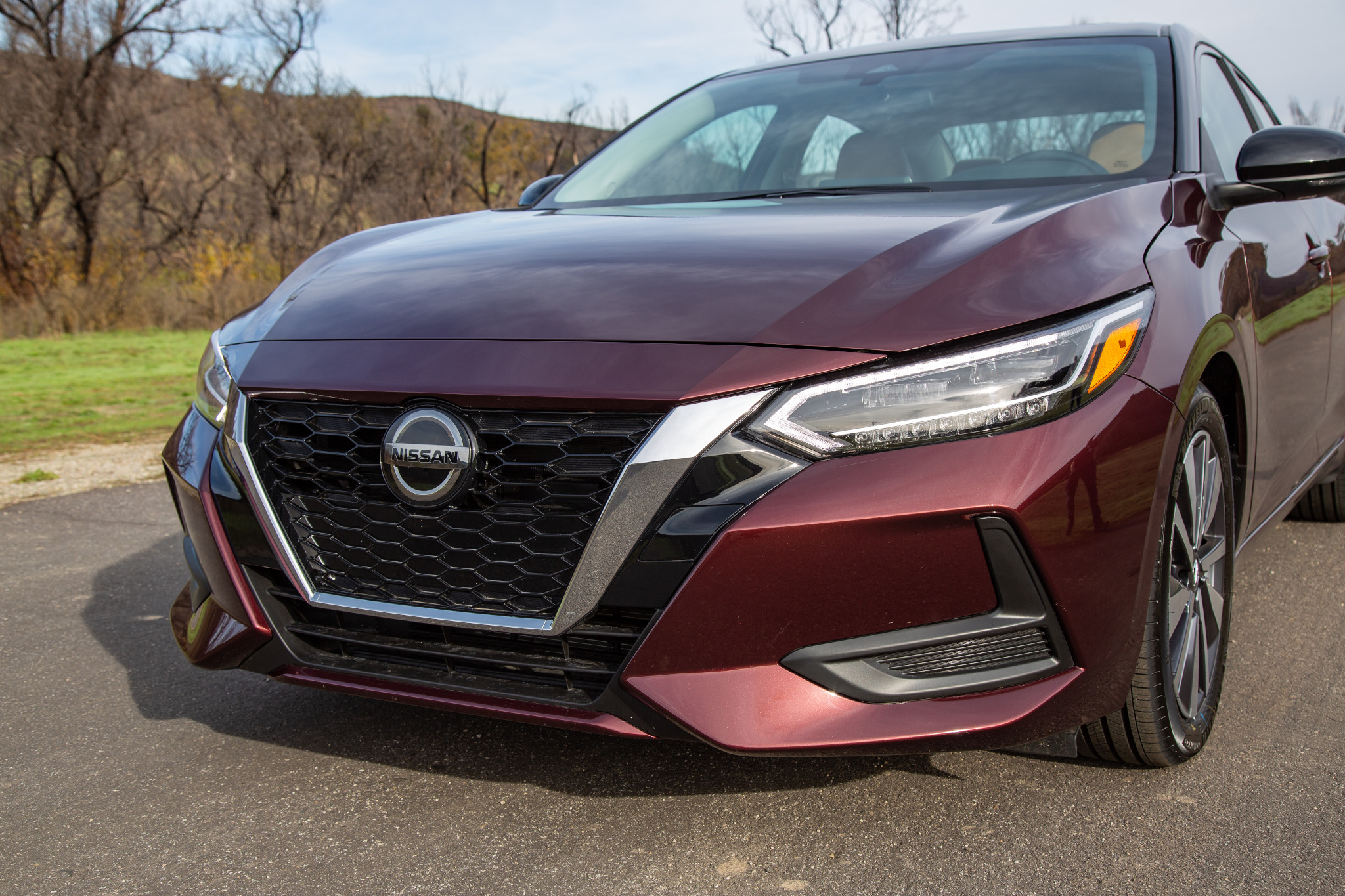 nissan-sentra-sv-2020-03-angle--exterior--front--red.jpg