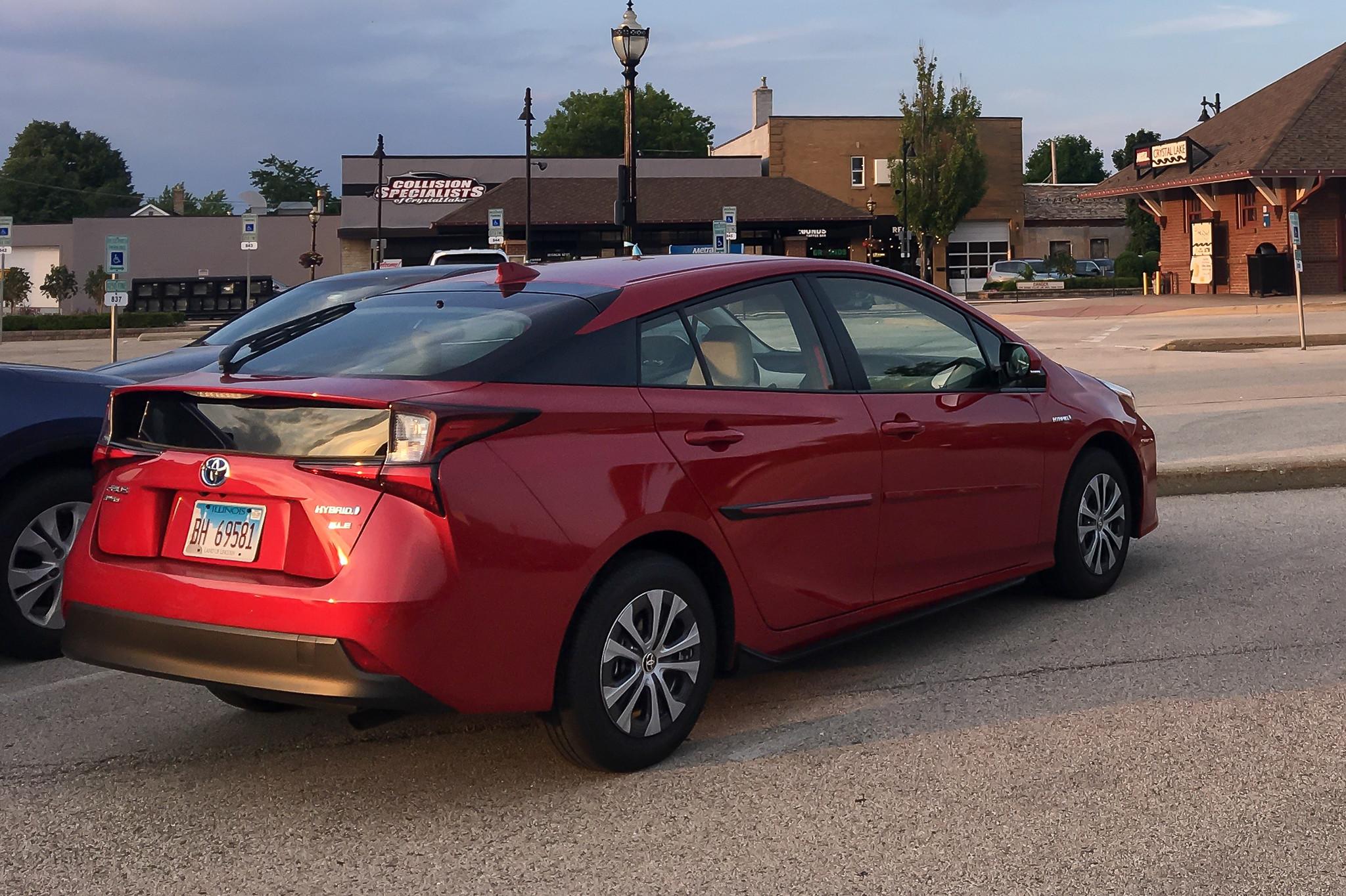 toyota-prius-awd-e-2019-01-angle--exterior--rear--red.jpg