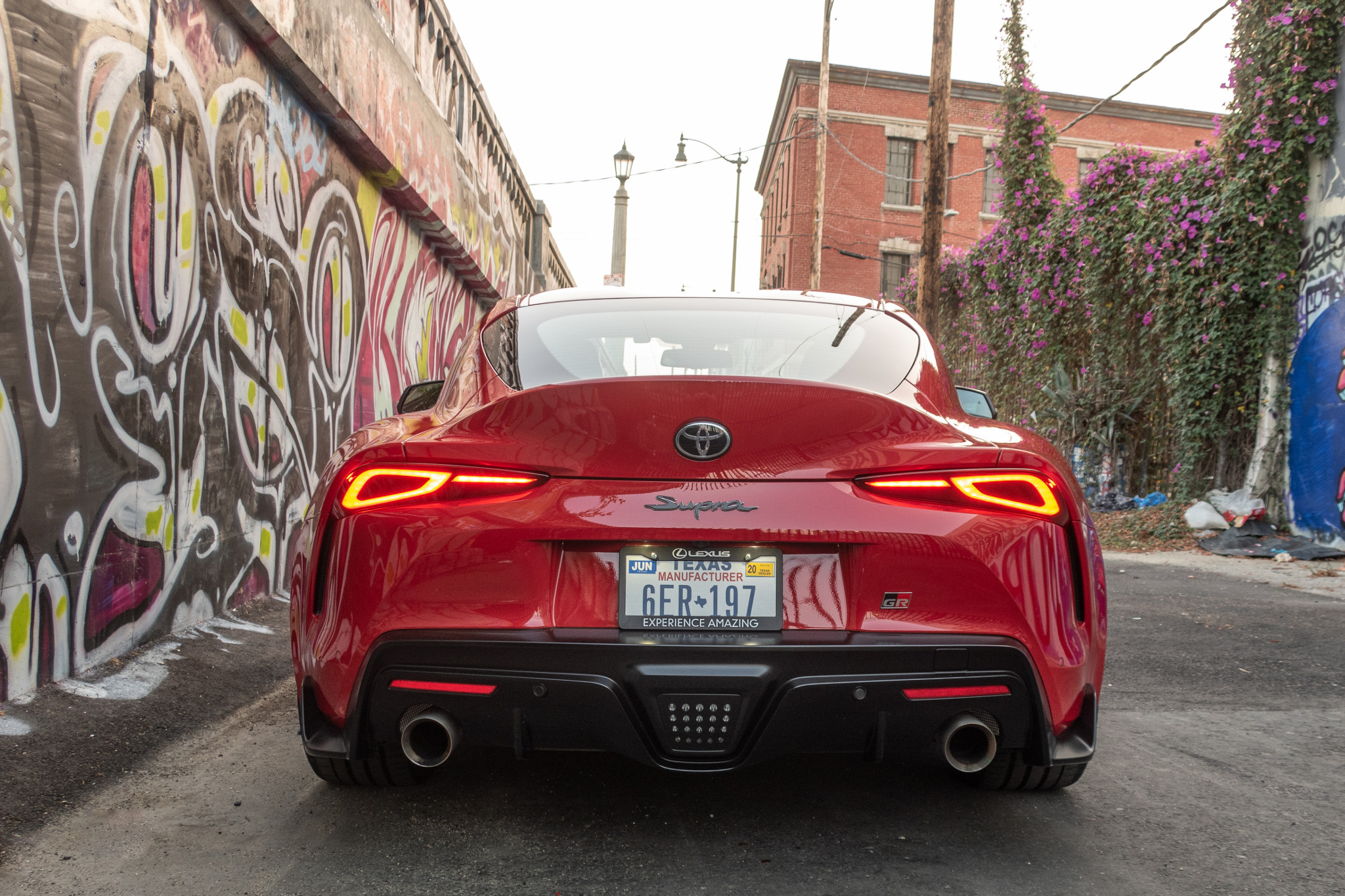 toyota-supra-2020-09-exterior--rear--red--textures-and-patterns--urban.jpg