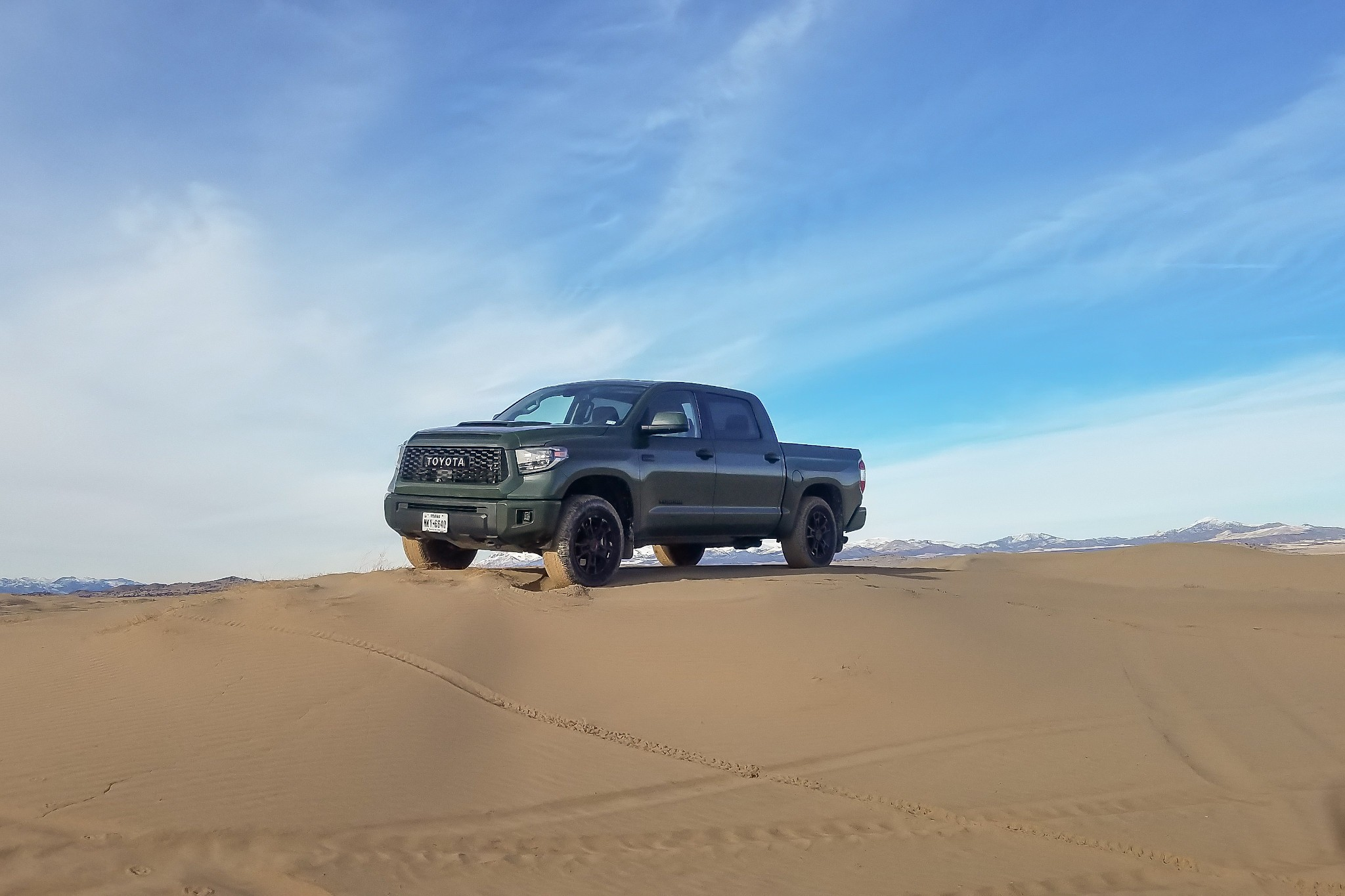 toyota-tundra-trd-pro-2020-1-angle--exterior--front--green--off-road--outdoors--sand--wide.jpg